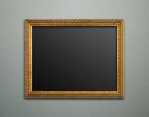 Empty golden vintage frame on wallpaper background