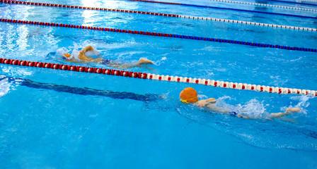 Two little boys swim