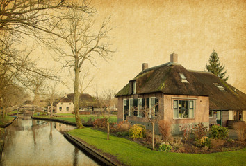 Canal in Giethoorn,  Netherlands.  Paper texture.