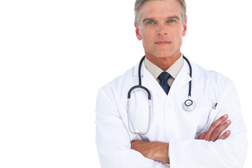 Serious man doctor with arms crossed