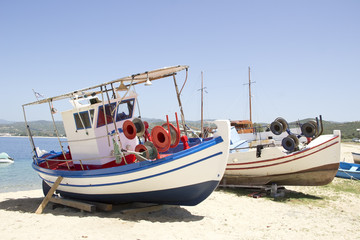 Two fishing boats at the sand beach