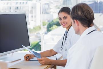 Pretty nurse holding a x ray