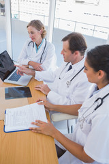 Overview of doctors working together on a laptop