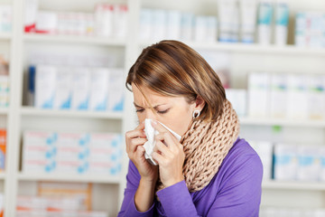 Woman with flu in the pharmacy