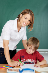 Smiling teacher and student