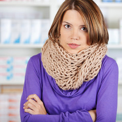 Sick woman with scarf in the pharmacy