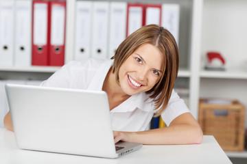 Happy businesswoman with laptop