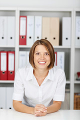 Friendly young woman in an office