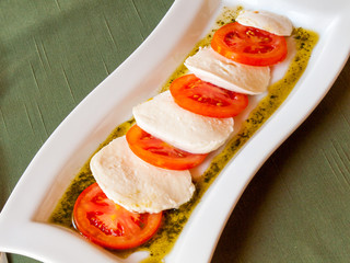 Summer Italian salad of red  tomatoes and mozzarella