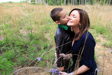 Young child kissing his mother's cheek