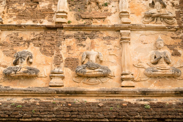 Ancient Buddha statue on Old pagoda in the Ancient buddhist temp