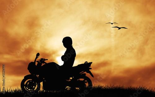 Wall mural motorcyclist at sunset
