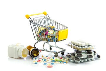 shopping trolley with pills isolated on white background