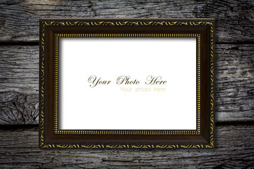 Old wood photo image frame on wood wall. (For putting your pictu