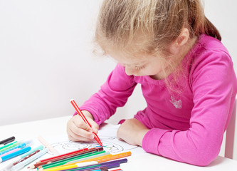 Five years old caucasian blond child girl drawing picture