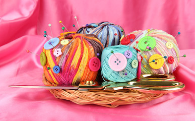 Colorful buttons and multicolor wool balls,