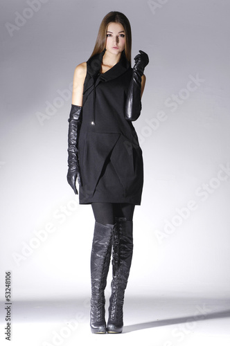Full Body Fashion Woman In Black Dress With Gloves Posing Stock