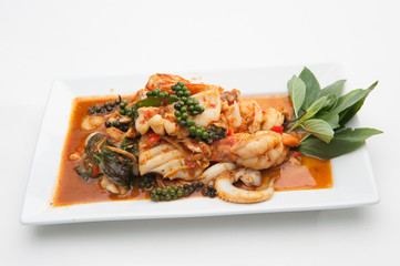 Spicy seafood fried served on white dish