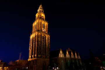 Fototapete - famous Martinitoren (Martini tower) in Groningen at night
