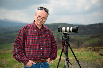 Senior photographer with camera