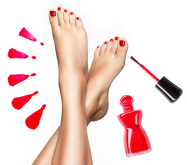 Wall Murals Pedicure Beautiful female legs with red pedicure and nail polish