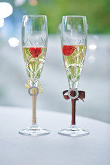 .Two wedding glasses of groom and bride on the table