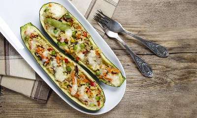Top view of zucchini stuffed with couscous vegetable salad on wo