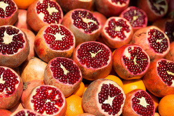 Many fresh pomegranates on market