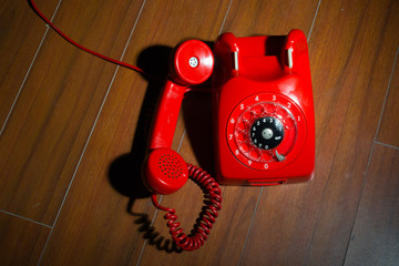 Rotary telephone on wooden background