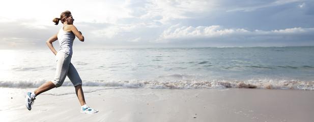 Woman running on the beach.