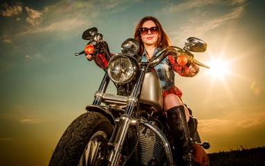 Papier Peint - Biker girl sitting on motorcycle