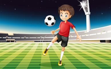 A soccer player kicking a ball
