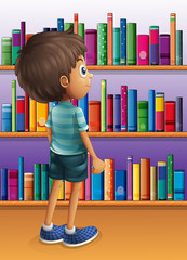 A boy searching a book in the library