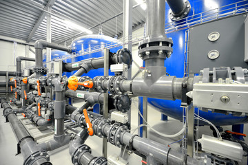 Poster Industrial geb. new plastic pipes in industrial boiler room