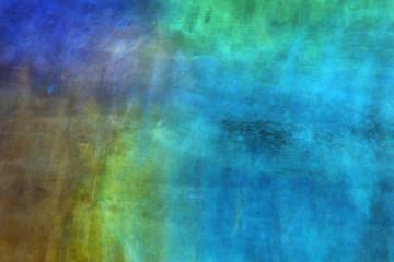 Fondo abstracto en tonos azules y terrosos.