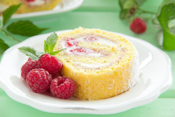 Roulade with raspberries and cream.
