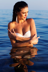 Bright portrait of a brunette resting in the water