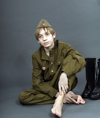 Teenage boy dressed in soviet uniform