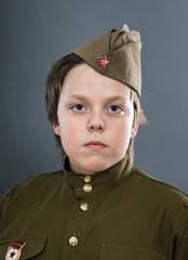 Teenage boy dressed in soviet uniform