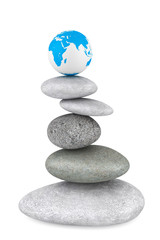 Stone pile in a Zen Garden with a Earth globe