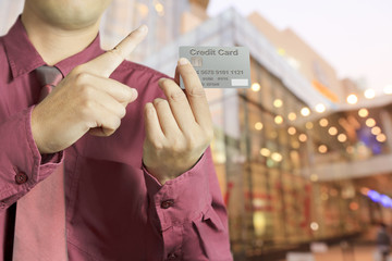 Cropped view of Businessman hand holding credit card