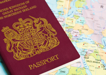 Passport or visa lying on a world map