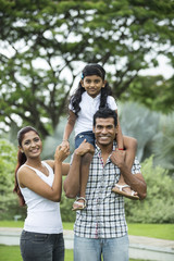 Happy Indian family at the park.