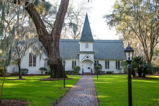 Small Church Past Brick Walk and Green Lawn Horizontal
