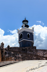 clouds form behind LIghthouse at  El Morro,