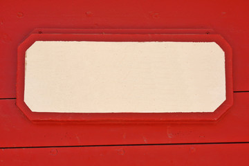 Wooden signboard on red planks background