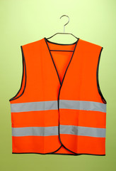 Orange vest, on color background