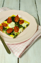 Spinach and tomato tart with feta cheese