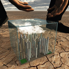 Tiny city in plastic box in desert landscape about to be picked