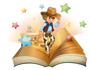 A book with a young cowboy in front of a saloon bar